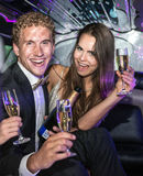 Jet set couple drinking champagne Royalty Free Stock Photography