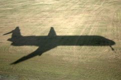Jet shadow landing Royalty Free Stock Images