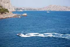 Jet ski. Riding jet ski near coastline Stock Photo