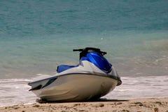 Jet ski. A jet ski on the beach stock photography
