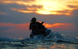 Jet ski. Water sport on the sunset Stock Photography