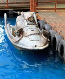 Jet ski. A modified, run down and abondoned jet ski moored on a dock stock photos