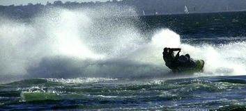 Jet ski. Moves through water stock image