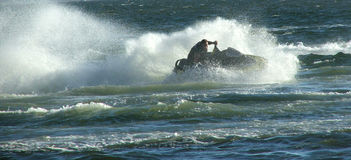 Jet ski. Moves through water stock images