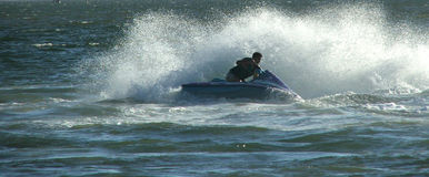 Jet ski. Moves through water royalty free stock images