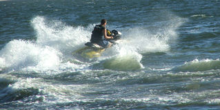 Jet ski. Moves through water royalty free stock photos