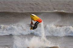 Jet Ski. A Man Flipping a Jet Ski on the Waves royalty free stock photo