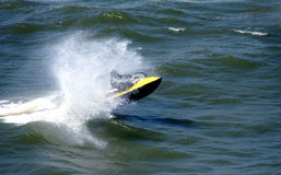 Jet ski. Water sports - Man riding a Jet ski over the sea waves stock photography