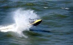 Jet ski. Water sports - Man riding a Jet ski over the sea waves stock photography