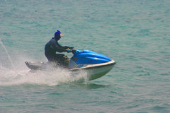 Jet ski action. Jet ski racing through the ocean royalty free stock photos