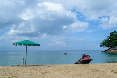 Jet ski on the beach and green umbrella in Phuket Royalty Free Stock Image