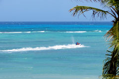 Jet Ski in Blue sea background with palm trees Stock Photography