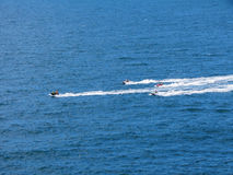 Jet Ski in the blue sea. People walking fast jet ski in the blue sea without waves Royalty Free Stock Images