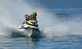 Jet Ski competitor cornering at speed creating at lot of spray. WYBOSTON, BEDFORDSHIRE, ENGLAND -  APRIL 09, 2017: Jet Ski competitor cornering at speed Stock Photography