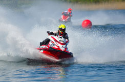 Jet Ski competitors cornering at speed creating at lot of spray. WYBOSTON, BEDFORDSHIRE, ENGLAND -  APRIL 09, 2017: Jet Ski competitors cornering at speed Royalty Free Stock Photos