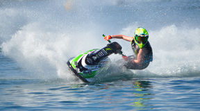 Jet Ski  cornering at speed creating at lot of spray. WYBOSTON, BEDFORDSHIRE, ENGLAND -  APRIL 09, 2017: Jet Ski  cornering at speed creating at lot of spray Royalty Free Stock Photography