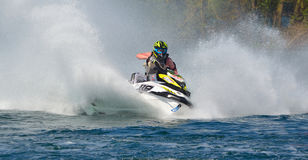 Jet Ski cornering at speed creating at lot of spray. WYBOSTON, BEDFORDSHIRE, ENGLAND -  APRIL 09, 2017: Jet Ski cornering at speed creating at lot of spray Stock Images