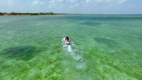 Jet ski on crystal clear water at Florida Keys. Having fun on a Jet ski on crystal clear water at Florida Keys Stock Photography