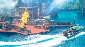 Women driving jet ski escape fire extreme action stock images
