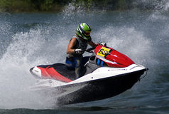 Jet Ski driver fly surrounded by waves Stock Photography