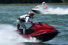Jet Ski driver standing rides boat Royalty Free Stock Images