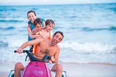 Jet ski. Excited family riding jet ski Royalty Free Stock Image