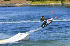 Jet Ski jumping over ramp Stock Photo