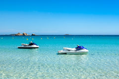 Jet ski mooring in the turquoise water of  Rondinara beach in Co Stock Images