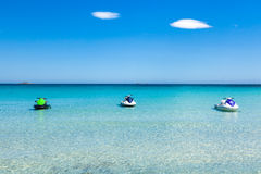 Jet ski mooring in the turquoise water of  Rondinara beach in Co Stock Image