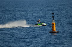 Jet Ski passing Buoy Royalty Free Stock Photos