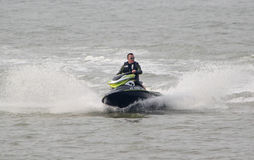 Jet ski power fun. Photo of jet ski man enjoying high powered fun on the ocean at herne bay seafront on 21st april 2014 and ideal for water sports,outdoor active Royalty Free Stock Photography