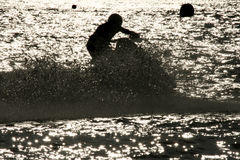 Jet Ski racer. Image of a Jet Ski racer Silhouetted by the sun Stock Images