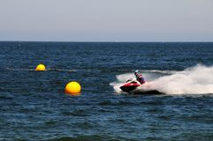 Jet ski racing around buoys. In ocean Royalty Free Stock Photography