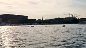 Jet-ski in the sea in Stockholm, Sweden. In Stockholm, the capital of Sweden during the summer, people have fun in the historic city centre with jet skis stock video footage
