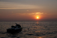 Jet ski silhouette in sunset. Stock Images
