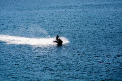 Jet Ski Sillouette on Blue Royalty Free Stock Images