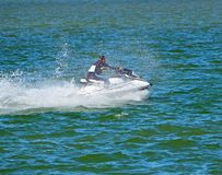 Jet Ski Speedster. Man wearing a wet suit speeding on a jet ski on the florida intra-coastal waterway off Miami Beach Stock Images