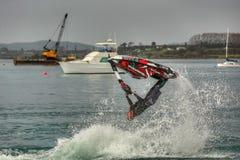 Jet Ski-stunts Een volledige backflip stock foto