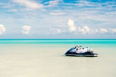 Jet ski on turquoise sea water in Antigua. Water transport, sport, activity. Speed, extreme, adrenaline. Summer vacation. On caribbean. Wanderlust, travel, trip stock images