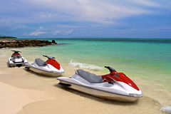 Jet Ski waiting at the shore. On a tropical beach Royalty Free Stock Photos