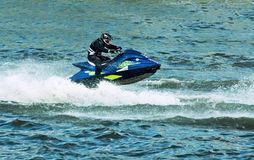 Jet ski water sport. High speed crazy jet ski water sport Royalty Free Stock Image