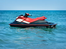 Jet-ski on waves of the sea against the blue sky Royalty Free Stock Photo