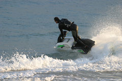 Jet Skier. Executing a high-speed turn royalty free stock images