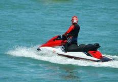 Jet skier on the florida intra-coastal waterway off Miami Beach. Man on a red jet ski cruising the florida intra-coastal waterway off Miami Beach stock image