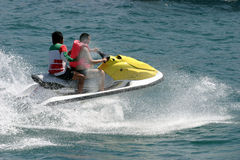 Jet skier racing royalty free stock photography