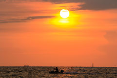 Jet-Skier and sunset at  Bangsaen , Chonburi, Thailand Stock Photos