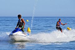 Jet skier and water skier, Marbella. Stock Image