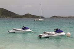 Jet Skies. Two jet skies tied up in the Caribbean Sea Stock Photo