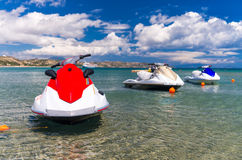 Jet skis anchored near the beach Royalty Free Stock Photos