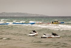 Jet skis floating on water on a coudy and windy day Royalty Free Stock Photography